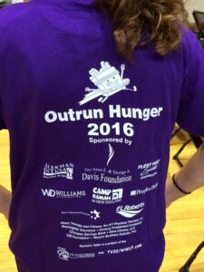 Back of tshirt for Outrun Hunger - Alkeman DiTusa sponsors of event