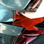 Head on motor vehicle collision with broken head lights.
