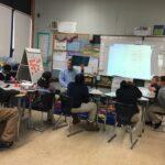 Ryan reading a book to a 4th grade class